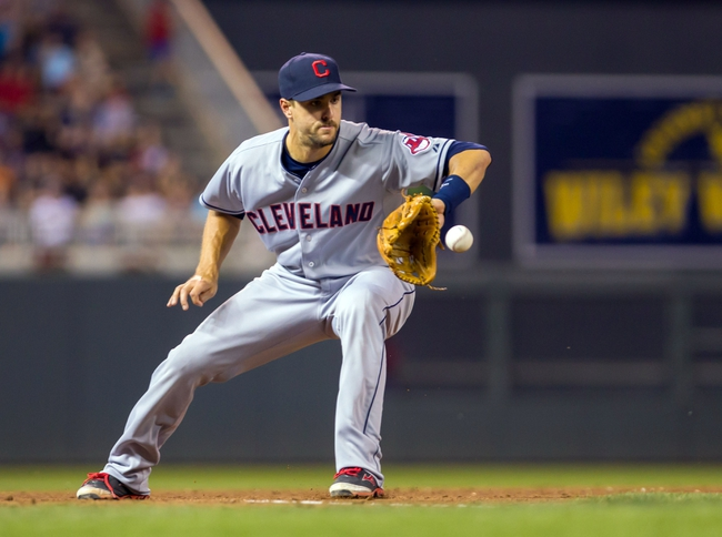 Jul 22, 2014; Minneapolis, MN, USA; Cleveland Indians third baseman Lonnie Chisenhall (8) fields a ground ball in the sixth inning against the Minnesota Twins at Target Field. The Cleveland Indians win 8-2. Mandatory Credit: Brad Rempel-USA TODAY Sports