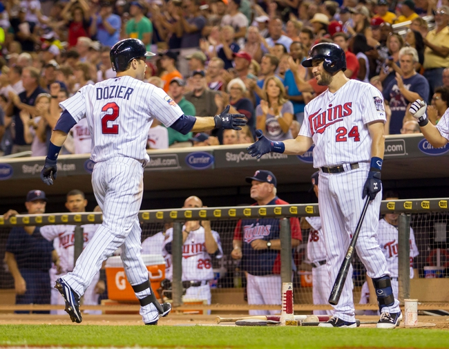Jul 22, 2014; Minneapolis, MN, USA; Minnesota Twins third baseman Trevor Plouffe (24) congratulates second baseman Brian Dozier (2) after his home run in the seventh inning against the Cleveland Indians at Target Field. The Cleveland Indians win 8-2. Mandatory Credit: Brad Rempel-USA TODAY Sports