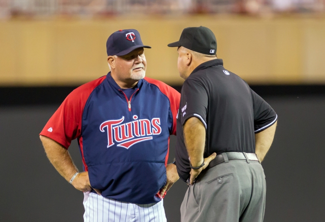 Jul 22, 2014; Minneapolis, MN, USA; Minnesota Twins manager Ron Gardenhire talks to second base umpire Brian O'Nora in the seventh inning against the Cleveland Indians at Target Field. The Cleveland Indians win 8-2. Mandatory Credit: Brad Rempel-USA TODAY Sports