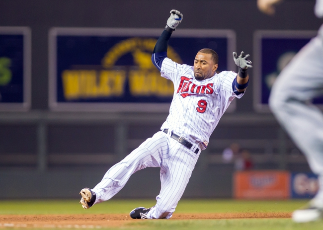 Jul 22, 2014; Minneapolis, MN, USA; Minnesota Twins shortstop Eduardo Nunez (9) slides into third after his triple in the eighth inning against the Cleveland Indians at Target Field. The Cleveland Indians win 8-2. Mandatory Credit: Brad Rempel-USA TODAY Sports