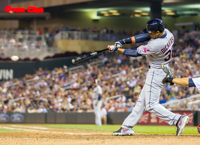 Jul 22, 2014; Minneapolis, MN, USA; Cleveland Indians left fielder Chris Dickerson (38) hits a single in the ninth inning against the Minnesota Twins at Target Field. The Cleveland Indians win 8-2. Mandatory Credit: Brad Rempel-USA TODAY Sports