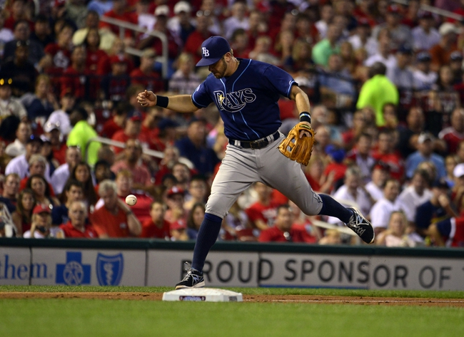 Jul 22, 2014; St. Louis, MO, USA; Tampa Bay Rays third baseman Evan Longoria (3) drops a ball hit by St. Louis Cardinals first baseman Matt Adams (not pictured) during the fourth inning at Busch Stadium. The Rays defeated the Cardinals 7-2. Mandatory Credit: Jeff Curry-USA TODAY Sports