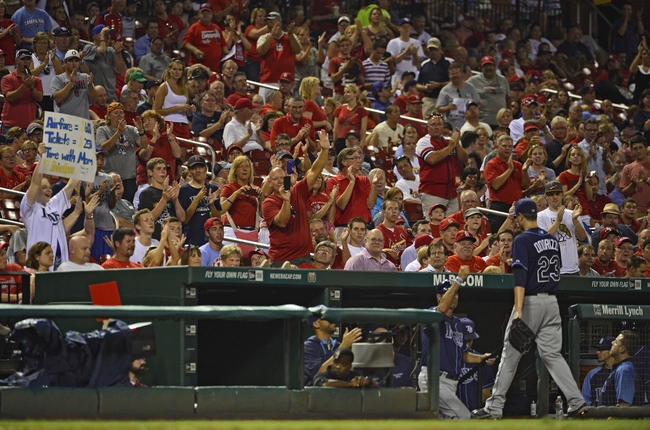Jul 22, 2014; St. Louis, MO, USA; Tampa Bay Rays starting pitcher Jake Odorizzi (23) receives a standing ovation from his home town crowd as he comes out of the game during the sixth inning against the St. Louis Cardinals at Busch Stadium. The Rays defeated the Cardinals 7-2. Mandatory Credit: Jeff Curry-USA TODAY Sports