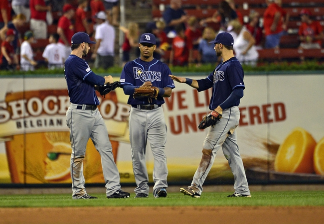 Jul 22, 2014; St. Louis, MO, USA; Tampa Bay Rays left fielder Matt Joyce (20), center fielder Desmond Jennings (8) and right fielder Kevin Kiermaier (39) celebrate after defeating the St. Louis Cardinals at Busch Stadium. The Rays defeated the Cardinals 7-2. Mandatory Credit: Jeff Curry-USA TODAY Sports