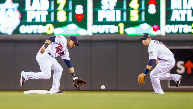 Jul 22, 2014; Minneapolis, MN, USA; Minnesota Twins shortstop Eduardo Escobar (5) fields a ground ball in the seventh inning against the Cleveland Indians at Target Field. The Cleveland Indians win 8-2. Mandatory Credit: Brad Rempel-USA TODAY Sports
