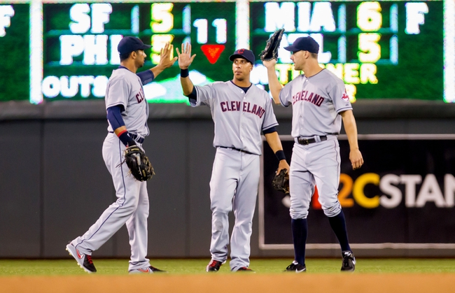Jul 22, 2014; Minneapolis, MN, USA; Cleveland Indians left fielder Chris Dickerson (left), center fielder Michael Brantley (center) and right fielder David Murphy (right) celebrate their win against the Minnesota Twins at Target Field. The Cleveland Indians win 8-2. Mandatory Credit: Brad Rempel-USA TODAY Sports