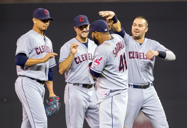 Jul 22, 2014; Minneapolis, MN, USA; Cleveland Indians designated hitter Nick Swisher (right) congratulates first baseman Carlos Santana (41) after their win against the Minnesota Twins at Target Field. The Cleveland Indians win 8-2. Mandatory Credit: Brad Rempel-USA TODAY Sports