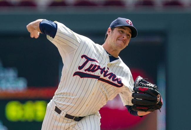 Jul 23, 2014; Minneapolis, MN, USA; Minnesota Twins relief pitcher Anthony Swarzak (51) pitches in the first inning against the Cleveland Indians at Target Field. Mandatory Credit: Brad Rempel-USA TODAY Sports