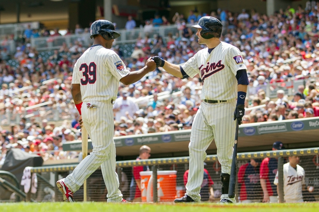 Jul 23, 2014; Minneapolis, MN, USA; Minnesota Twins second baseman Brian Dozier (2) congratulates center fielder Danny Santana (39) after scoring in the third inning against the Cleveland Indians at Target Field. Mandatory Credit: Brad Rempel-USA TODAY Sports