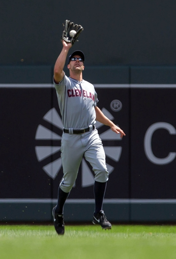 Jul 23, 2014; Minneapolis, MN, USA; Cleveland Indians right fielder David Murphy (7) catches a pop fly in the fourth inning against the Minnesota Twins at Target Field. Mandatory Credit: Brad Rempel-USA TODAY Sports