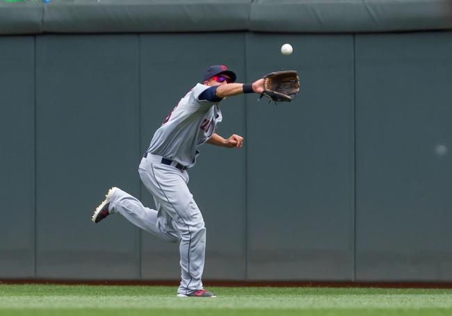 Jul 23, 2014; Minneapolis, MN, USA; Cleveland Indians center fielder Michael Brantley (23) catches a pop fly in the eighth inning against the Minnesota Twins at Target Field. The Minnesota Twins win 3-1. Mandatory Credit: Brad Rempel-USA TODAY Sports