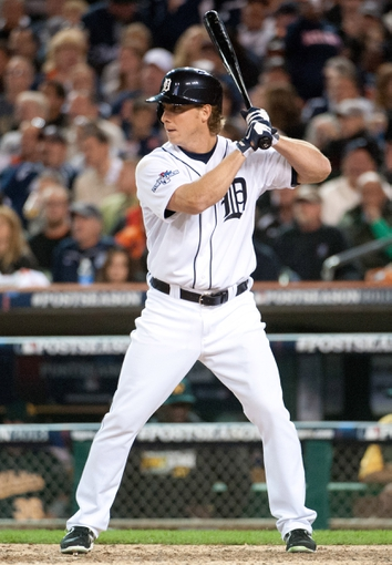 Oct 8, 2013; Detroit, MI, USA; Detroit Tigers left fielder Andy Dirks (12) bats in game four of the American League divisional series against the Oakland Athletics at Comerica Park. Mandatory Credit: Tim Fuller-USA TODAY Sports