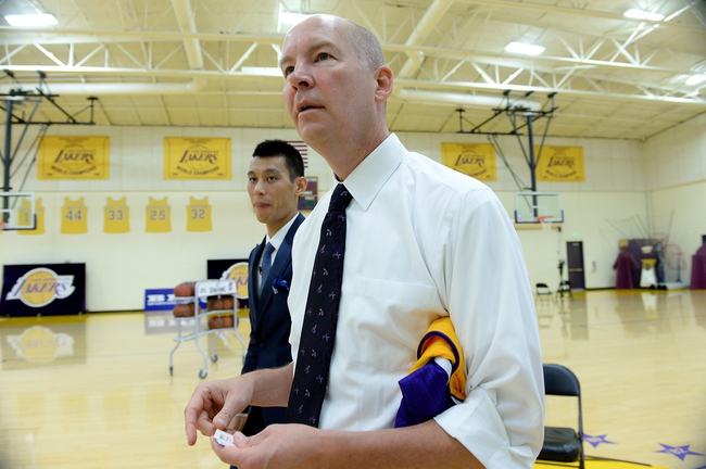 Jul 24, 2014; El Segundo, CA, USA; Los Angeles Lakers vice president of public relations John Black walks with Jeremy Lin as they enter the room for a press conference at the Toyota Sports Center. Mandatory Credit: Jayne Kamin-Oncea-USA TODAY Sports