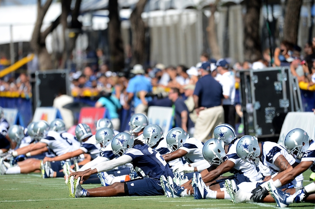 Jul 24, 2014; Oxnard, CA, USA; Dallas Cowboys players stretch on the first day of training camp at the River Ridge Playing Fields.  Mandatory Credit: Jayne Kamin-Oncea-USA TODAY Sports