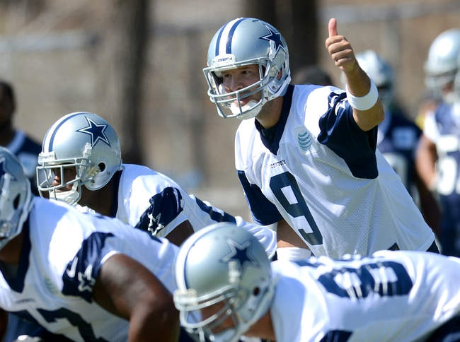 Jul 24, 2014; Oxnard, CA, USA; Dallas Cowboys quarterback Tony Romo (9) goes through drills during training camp at the River Ridge Playing Fields.  Mandatory Credit: Jayne Kamin-Oncea-USA TODAY Sports