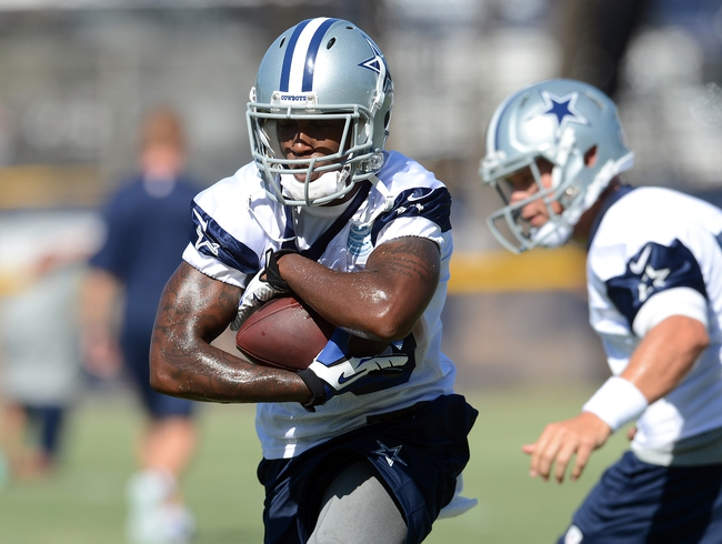Jul 24, 2014; Oxnard, CA, USA; Dallas Cowboys running back Lance Dunbar (25) runs the ball during training camp at the River Ridge Playing Fields.  Mandatory Credit: Jayne Kamin-Oncea-USA TODAY Sports