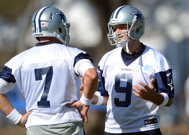Jul 24, 2014; Oxnard, CA, USA; Dallas Cowboys quarterback Tony Romo (9) talks with quarterback Caleb Hanie (7) during training camp at the River Ridge Playing Fields.  Mandatory Credit: Jayne Kamin-Oncea-USA TODAY Sports
