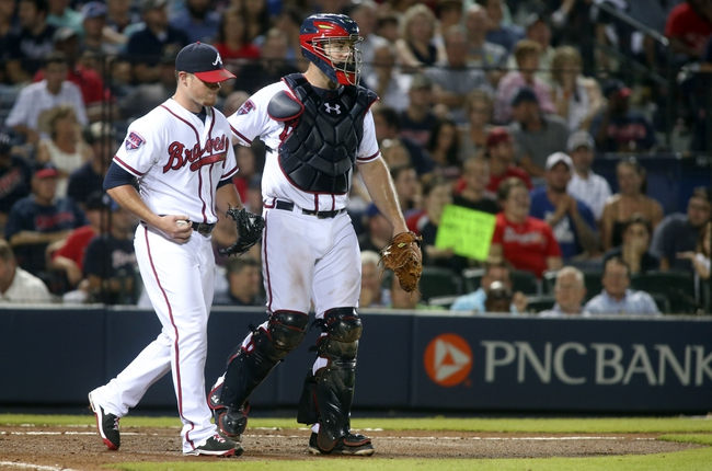 Jul 24, 2014; Atlanta, GA, USA; Atlanta Braves catcher Evan Gattis (24) consoles Atlanta Braves relief pitcher Craig Kimbrel (46) after giving up a run in the ninth inning of their game against the Miami Marlins at Turner Field. Marlins won 3-2. Mandatory Credit: Jason Getz-USA TODAY Sports