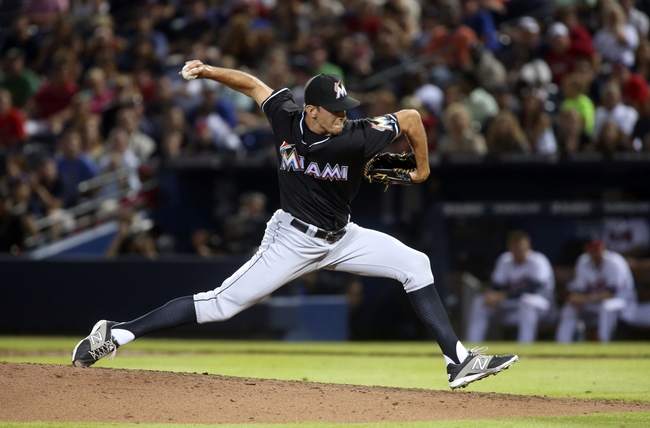 Jul 24, 2014; Atlanta, GA, USA; Miami Marlins relief pitcher Steve Cishek (31) delivers a pitch in the ninth inning of their game against the Atlanta Braves at Turner Field. Marlins won 3-2. Mandatory Credit: Jason Getz-USA TODAY Sports