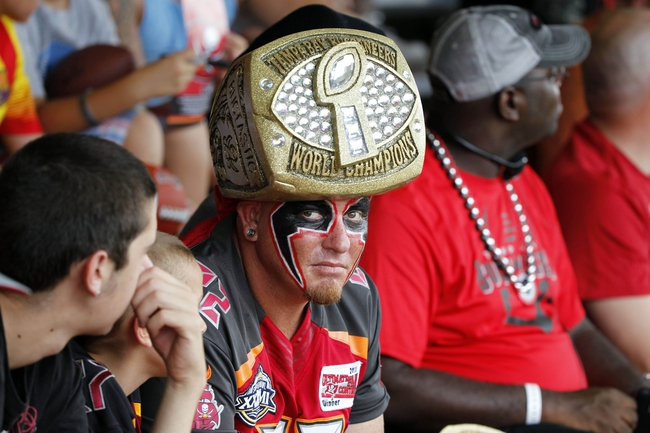 Jul 25, 2014; Tampa Bay, FL, USA; Tampa Bay Buccaneers fans watch during training camp at One Bucs Place. Mandatory Credit: Kim Klement-USA TODAY Sports