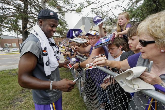 Jul 25, 2014; Mankato, MN, USA; Minnesota Vikings quarterback Teddy Bridgewater (5) signs autographs for fans after training camp practice at Minnesota State University. Mandatory Credit: Bruce Kluckhohn-USA TODAY Sports