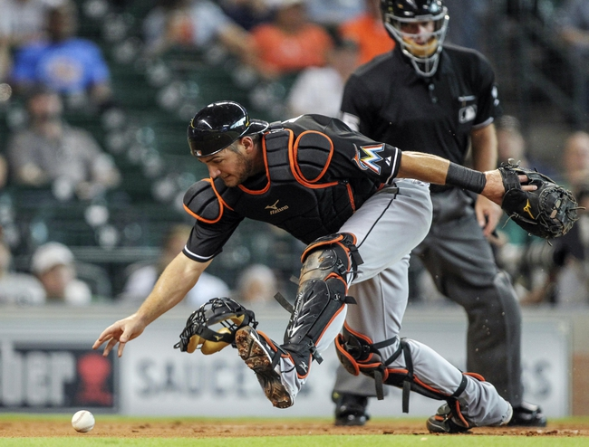 Jul 25, 2014; Houston, TX, USA; Miami Marlins catcher Jeff Mathis (6) chases a ball that gets away from him during the first inning against the Houston Astros at Minute Maid Park. Mandatory Credit: Troy Taormina-USA TODAY Sports