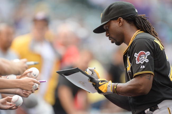 Jul 25, 2014; Denver, CO, USA; Pittsburgh Pirates center fielder Andrew McCutchen (22) signs autographs before the start of the game against the Colorado Rockies at Coors Field. Mandatory Credit: Ron Chenoy-USA TODAY Sports