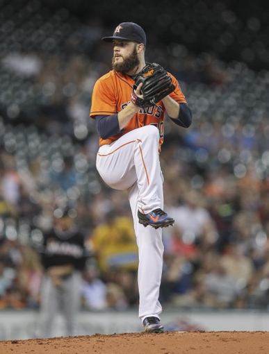 Jul 25, 2014; Houston, TX, USA; Houston Astros starting pitcher Dallas Keuchel (60) pitches during the third inning against the Miami Marlins at Minute Maid Park. Mandatory Credit: Troy Taormina-USA TODAY Sports