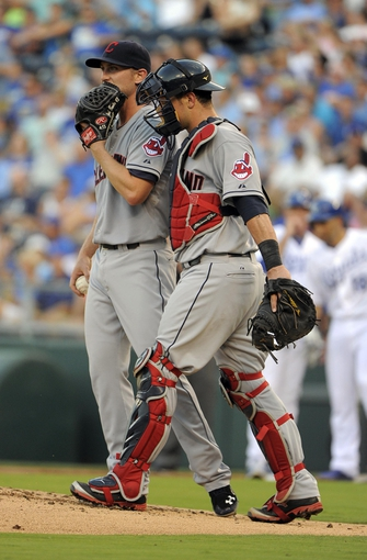 Jul 25, 2014; Kansas City, MO, USA; Cleveland Indians starting pitcher Josh Tomlin (43) talks to catcher Yan Gomes (10) after giving up a home run to the Kansas City Royals in the second inning at Kauffman Stadium. Mandatory Credit: John Rieger-USA TODAY Sports