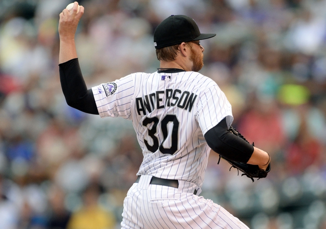 Jul 25, 2014; Denver, CO, USA; Colorado Rockies starting pitcher Brett Anderson (30) delivers a pitch in the first inning against the Pittsburgh Pirates at Coors Field. Mandatory Credit: Ron Chenoy-USA TODAY Sports