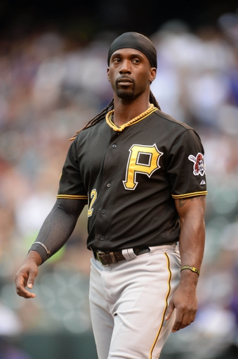 Jul 25, 2014; Denver, CO, USA; Pittsburgh Pirates center fielder Andrew McCutchen (22) during the first inning against the Colorado Rockies at Coors Field. Mandatory Credit: Ron Chenoy-USA TODAY Sports