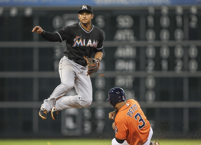Jul 25, 2014; Houston, TX, USA; Miami Marlins second baseman Donovan Solano (17) throws to first base as Houston Astros shortstop Gregorio Petit (3) is forced out during the third inning at Minute Maid Park. Mandatory Credit: Troy Taormina-USA TODAY Sports