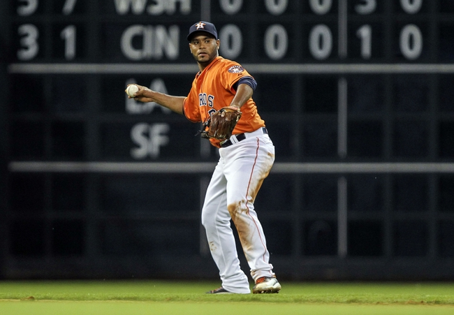 Jul 25, 2014; Houston, TX, USA; Houston Astros shortstop Gregorio Petit (3) is unable to make a play on a ground ball during the fourth inning against the Miami Marlins at Minute Maid Park. Mandatory Credit: Troy Taormina-USA TODAY Sports