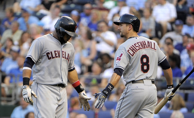 Jul 25, 2014; Kansas City, MO, USA; Cleveland Indians first baseman Carlos Santana (41) is congratulated by third baseman Lonnie Chisenhall (8) after hitting a home run against the Kansas City Royals in the fourth inning at Kauffman Stadium. Mandatory Credit: John Rieger-USA TODAY Sports