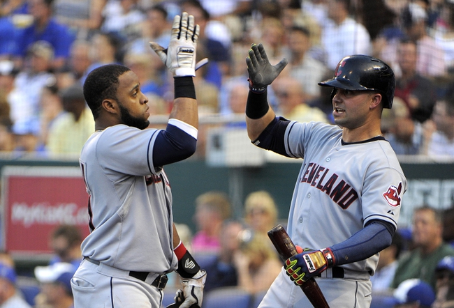 Jul 25, 2014; Kansas City, MO, USA; Cleveland Indians first baseman Carlos Santana (41) is congratulated by first baseman Nick Swisher (33) after hitting a home run against the Kansas City Royals in the fourth inning at Kauffman Stadium. Mandatory Credit: John Rieger-USA TODAY Sports