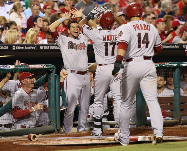 Jul 25, 2014; Philadelphia, PA, USA; Arizona Diamondbacks left fielder Alfredo Marte (17) walks back to the dugout and is congratulated by team mates after hitting a grand slam home run during the sixth inning of a game against the Philadelphia Phillies at Citizens Bank Park. Mandatory Credit: Bill Streicher-USA TODAY Sports