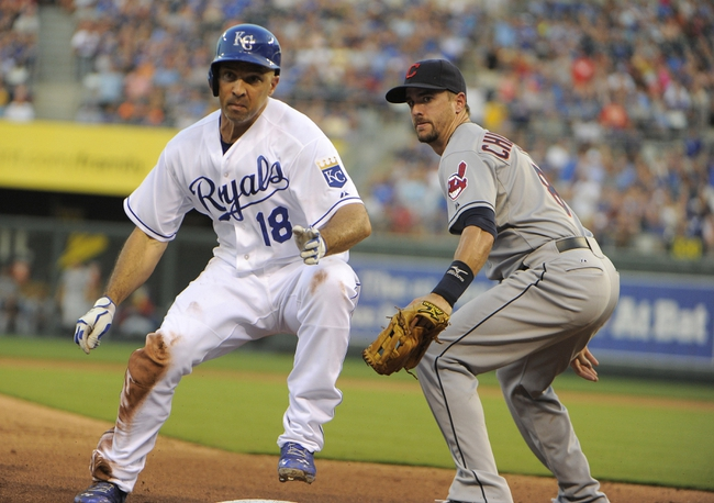 Jul 25, 2014; Kansas City, MO, USA; Kansas City Royals right fielder Raul Ibanez (18) is safe at third base as the ball gets away from Cleveland Indians third baseman Lonnie Chisenhall (8) in the fourth inning at Kauffman Stadium. Ibanez scored on a throwing error by Indians second baseman Jason Kipnis (not shown). Mandatory Credit: John Rieger-USA TODAY Sports