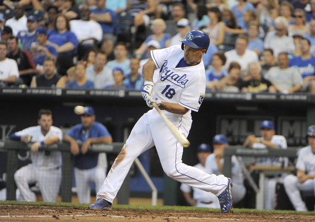Jul 25, 2014; Kansas City, MO, USA; Kansas City Royals right fielder Raul Ibanez (18) hits a triple against the Cleveland Indians in the fourth inning at Kauffman Stadium. Mandatory Credit: John Rieger-USA TODAY Sports