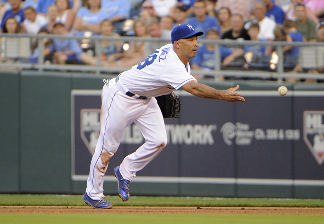 Jul 25, 2014; Kansas City, MO, USA; Kansas City Royals right fielder Raul Ibanez (18) tosses the ball to  pitcher Yordano Ventura (not shown) at first base on a grounder against the Cleveland Indians in the fourth inning at Kauffman Stadium. Mandatory Credit: John Rieger-USA TODAY Sports