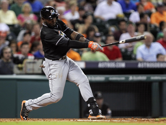Jul 25, 2014; Houston, TX, USA; Miami Marlins center fielder Marcell Ozuna (13) gets a single during the fifth inning against the Houston Astros at Minute Maid Park. Mandatory Credit: Troy Taormina-USA TODAY Sports