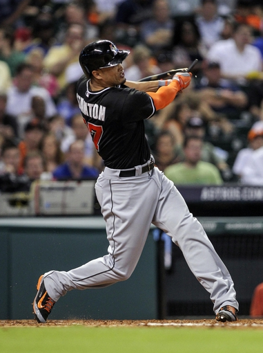 Jul 25, 2014; Houston, TX, USA; Miami Marlins right fielder Giancarlo Stanton (27) breaks his bat on a ground ball during the sixth inning against the Houston Astros at Minute Maid Park. Mandatory Credit: Troy Taormina-USA TODAY Sports