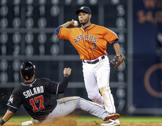Jul 25, 2014; Houston, TX, USA; Houston Astros shortstop Gregorio Petit (3) throws to first base to complete a double play during the sixth inning as Miami Marlins second baseman Donovan Solano (17) is out at second at Minute Maid Park. Mandatory Credit: Troy Taormina-USA TODAY Sports