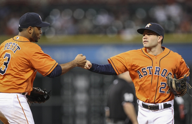 Jul 25, 2014; Houston, TX, USA; Houston Astros shortstop Gregorio Petit (3) is congratulated by second baseman Jose Altuve (27) after a double play during the sixth inning against the Miami Marlins at Minute Maid Park. Mandatory Credit: Troy Taormina-USA TODAY Sports