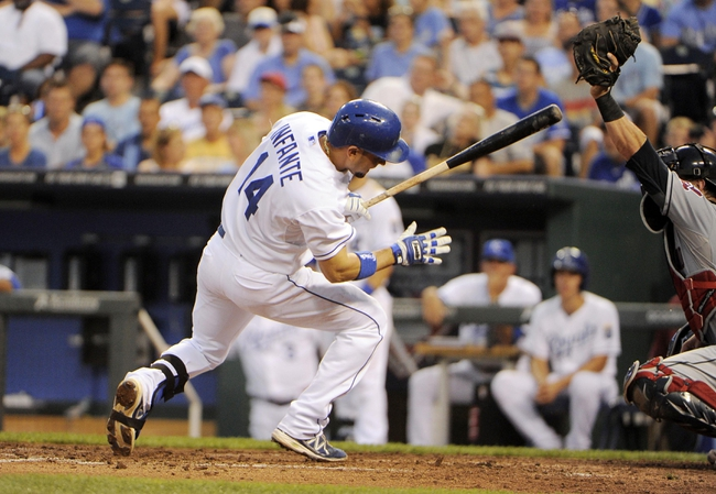 Jul 25, 2014; Kansas City, MO, USA; Kansas City Royals right fielder Raul Ibanez (18) jumps back from a pitch against the Cleveland Indians in the fifth inning at Kauffman Stadium. Mandatory Credit: John Rieger-USA TODAY Sports