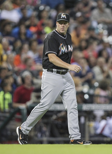 Jul 25, 2014; Houston, TX, USA; Miami Marlins manager Mike Redmond (11) walks onto the field to challenge a call during the sixth inning against the Houston Astros at Minute Maid Park. Mandatory Credit: Troy Taormina-USA TODAY Sports