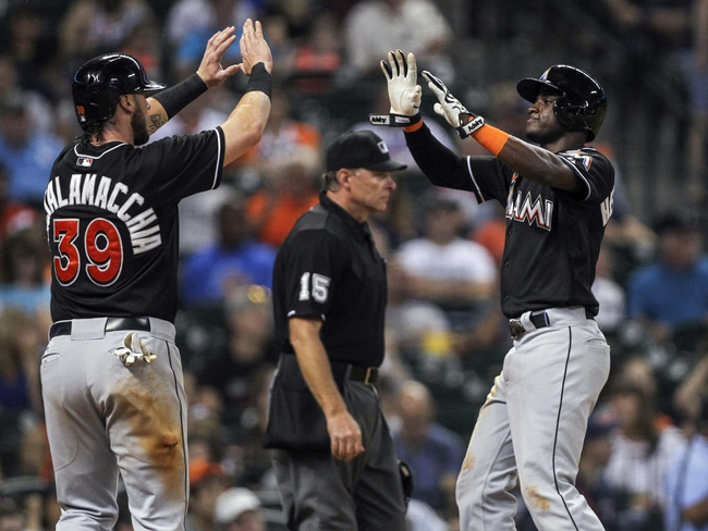 Jul 25, 2014; Houston, TX, USA; Miami Marlins designated hitter Jarrod Saltalamacchia (39) and shortstop Adeiny Hechavarria (3) score during the seventh inning against the Houston Astros at Minute Maid Park. Mandatory Credit: Troy Taormina-USA TODAY Sports