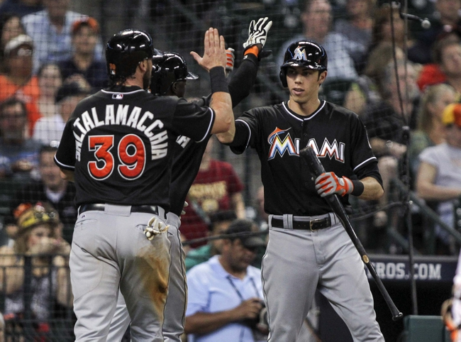 Jul 25, 2014; Houston, TX, USA; Miami Marlins designated hitter Jarrod Saltalamacchia (39) is congratulated by left fielder Christian Yelich (21) after scoring a run during the seventh inning against the Houston Astros at Minute Maid Park. Mandatory Credit: Troy Taormina-USA TODAY Sports