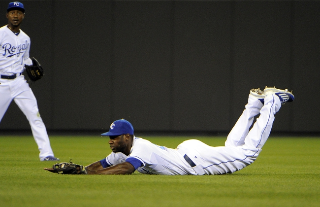 Jul 25, 2014; Kansas City, MO, USA; Kansas City Royals center fielder Lorenzo Cain (6) catches a fly ball by Cleveland Indians second baseman Jason Kipnis (not shown) in the seventh inning at Kauffman Stadium. Mandatory Credit: John Rieger-USA TODAY Sports