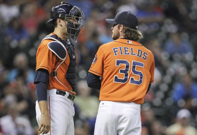 Jul 25, 2014; Houston, TX, USA; Houston Astros catcher Jason Castro (15) talks with relief pitcher Josh Fields (35) during the eighth inning against the Miami Marlins at Minute Maid Park. Mandatory Credit: Troy Taormina-USA TODAY Sports