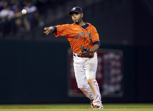 Jul 25, 2014; Houston, TX, USA; Houston Astros shortstop Gregorio Petit (3) throws to first base during the ninth inning against the Miami Marlins at Minute Maid Park. Mandatory Credit: Troy Taormina-USA TODAY Sports